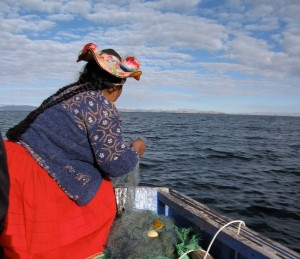 Early morning fishing with a local woman on Lake Titicaca