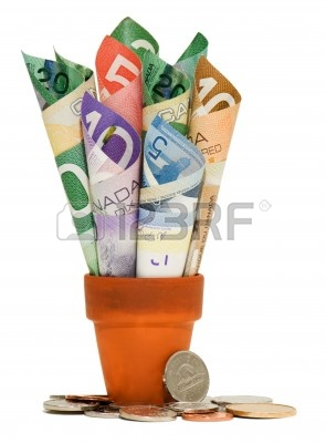 6786313-canadian-bills-rolled-up-in-a-terra-cotta-pot-with-coins-at-the-base
